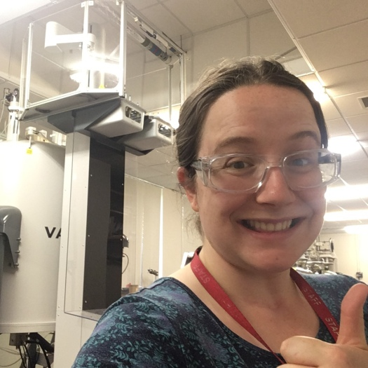 Fiona giving a thumbs up in the NMR lab