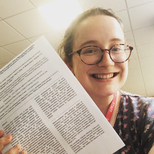 Selfie of Fiona holding a copy of her scientific paper