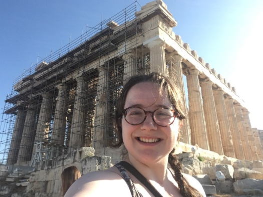 Selfie of Fiona smiling in front of the Parthenon temple in Athens