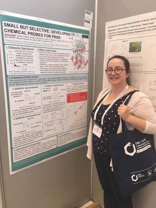 Fiona standing in front of a poster summarising her PhD