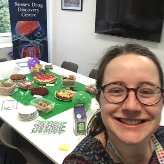 Selfie of Fiona infront of The spread for her macmillan coffee morning at work